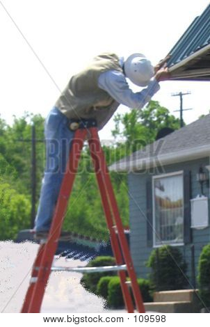 Man Working On A Roof