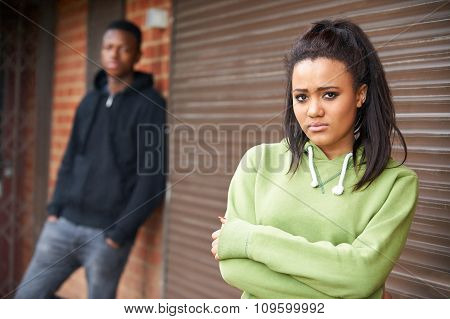 Unhappy Teenage Couple In Urban Setting