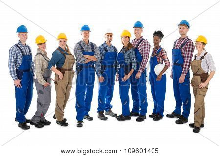 Confident Carpenters Standing In Row