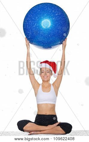 Smiling Asian Woman In Christmas Cap Holds Pilates Balls Undersnow