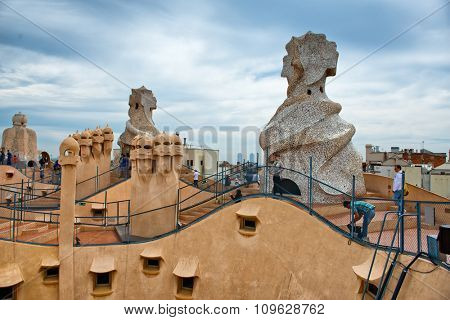 BARCELONA, SPAIN - MAY 01. Gaudi Chimneys at Casa Mila (also known as La Pedrera) on May 1, 2015 in Barcelona. Terrace of the Casa Mila, with chimneys shaped anthropomorphic soldiers, created by Gaudi