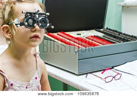 Young Girl Is At The Optometrist, Optician Office Doing Eye Check