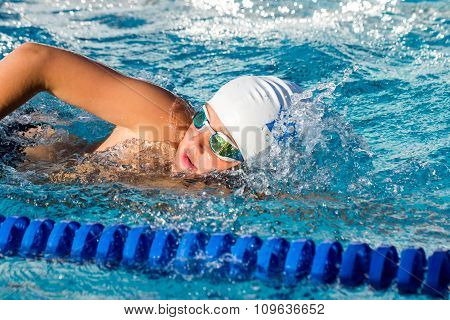Close Up Of Young Student Swimming.