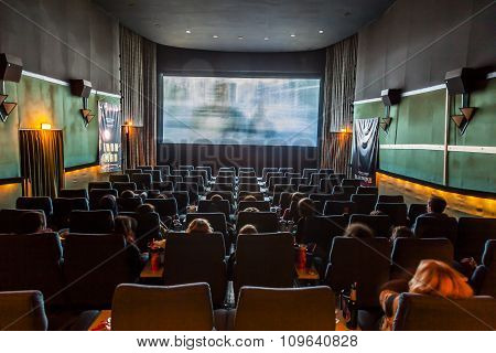 Children Enjoy A Film At An Old Traditional Cinema