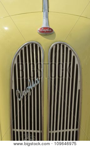 Classic Yellow Ford Anglia motor car bonnet and grill