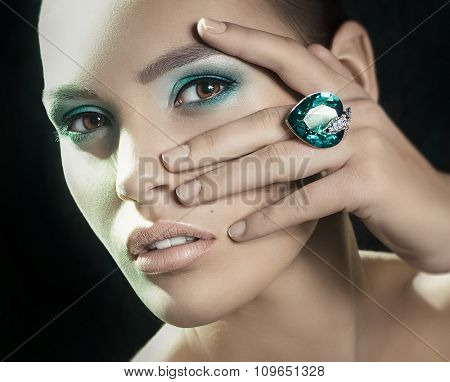 Beautiful girl with makeup in luxury jewelry