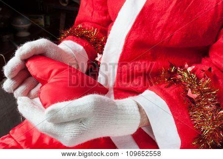 Santa Claus holding a heart