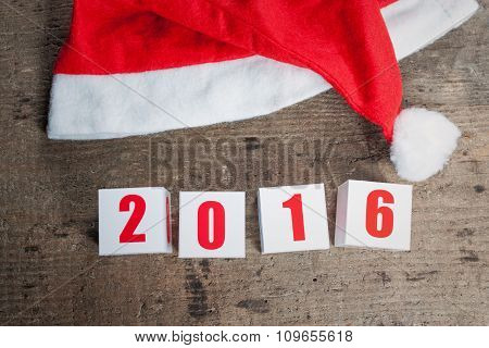 Greeting card of New Year on wooden background
