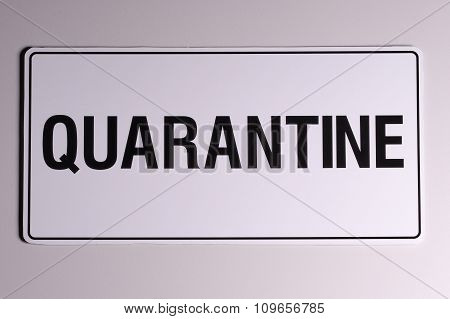 Quarantine wall sign in black on off white background