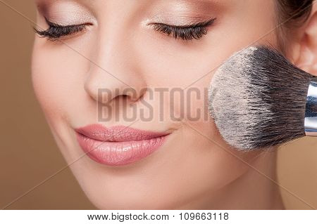 Pretty female model is receiving facial treatment