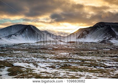 Snowy Icelandic Mountains With Dramatic Cloudy Sky