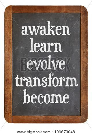 awaken, learn, evolve, transform and become - inspirational words on a vintage slate blackboard - personal growth concept