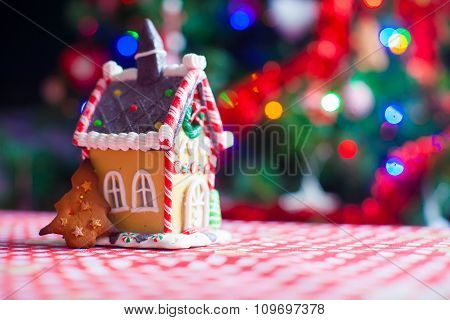 Cute gingerbread cookie and candy ginger house background Christmas tree lights