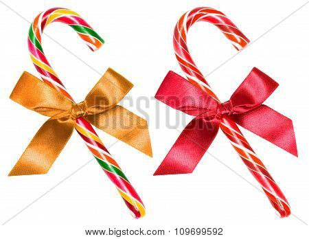 Striped candy cane with bow isolated over white, clipping path