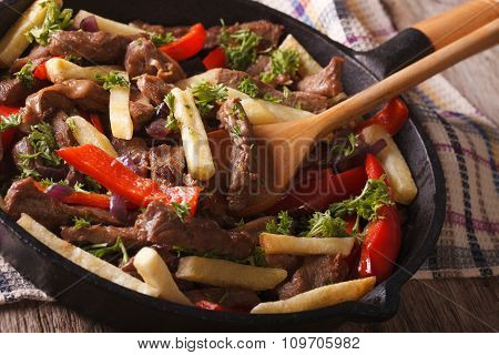Peruvian Food: Lomo Saltado Close-up In A Frying Pan. Horizontal
