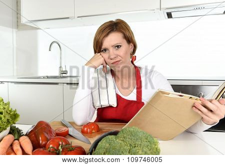 Upset Cook Woman Bored And Frustrated Reading Recipes Book In Home Kitchen In Stress