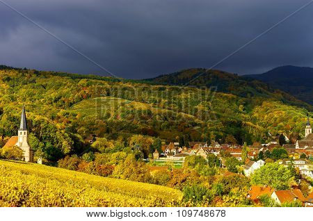 Vivid colors of autumn vineyards in Andlau Alsace. Contrast colorful weather. Season concept. poster