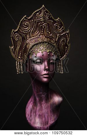 Mannequin girl in headwear, isolated on black background poster