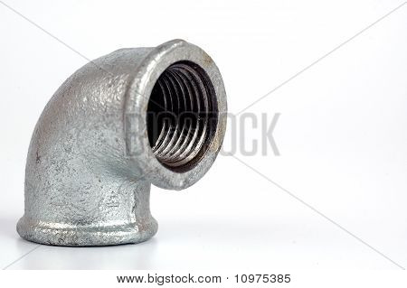 Malleable Iron Elbow 90° Closeup On The White Background