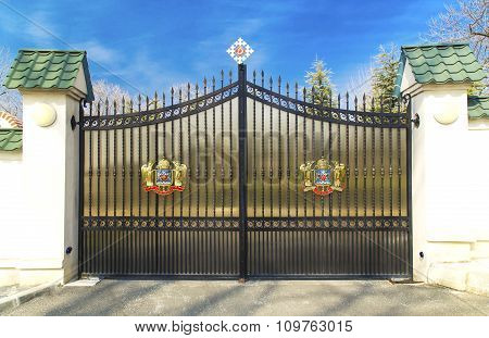 Metal door with Coat of Arms of Romanian Orthodox Church on March 13, 2015 in Bucharest, Romania