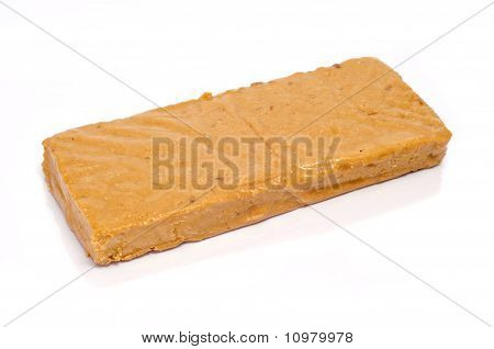 a bar of turron de Jijona typical Christmas sweet of Spain poster