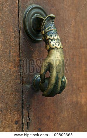 Door handle woman's hand taken in Gras France