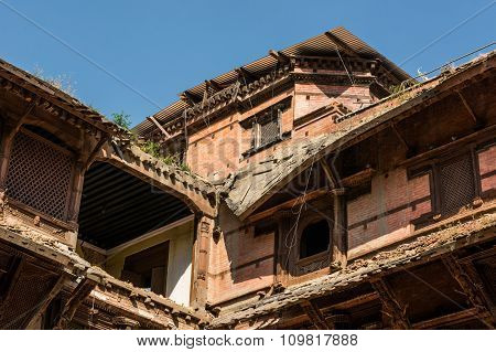 Closeup of ruined rooftops.