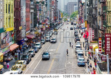 NEW YORK CITY - JULY 15: Tourists shop at businesses along a busy street in historic Chinatown during 4th of July festivities, July 4, 2015 in New York City, New York.