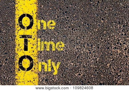 Concept image of Accounting Business Acronym OTO One Time Only written over road marking yellow paint line. poster