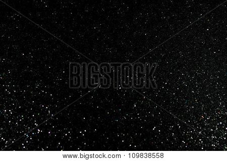 Glittering fashion black background with twinkling grainy texture