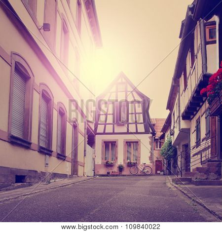 Small village Riquewihr in the Alsace at sunset. Vintage image.