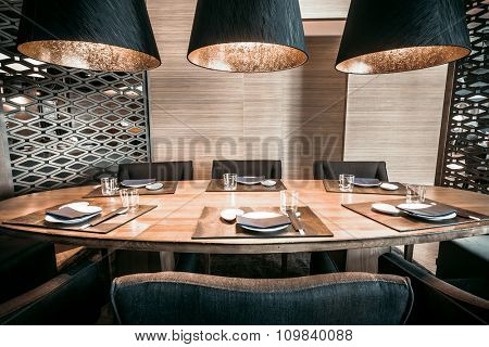 Interior modern restaurant with table, chairs and tableware