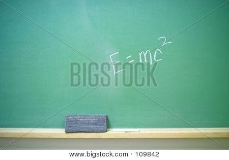 Albert Einstein's famous E=mc2 equation on a horizontal green chalkboard. (14MP camera) poster