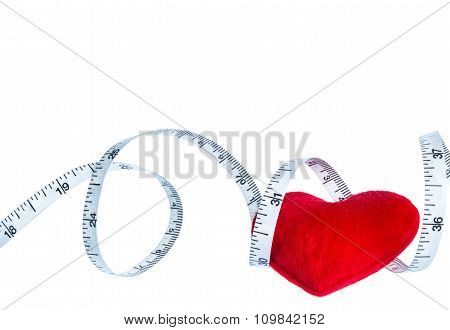 Close Up Red Heart With Measuring Tape, Isolated On White Background.