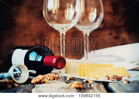 Still Life With Red Wine, Glasses, Walnuts, Cheese. Rural Style