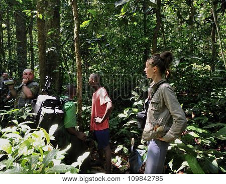 Beautiful Girl With Group Of Tourists In Jungle Near By Mondica Camp. The Borderland Between The Con