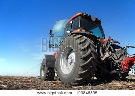 Tractor Working In The Field Sunny Day