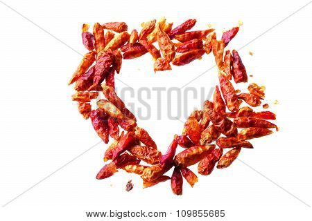 Dried Red Chili Peppers In A Heart Shape Isolated On A White Background, Love Concept And  Heart Hea