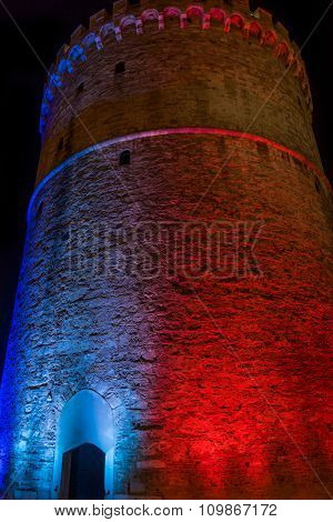 The white tower of Thessaloniki Greece illuminated with the colors of the French flag in memory of the Jihadists ISIS Terrorist Raid in Paris, 2015 in Thessaloniki.