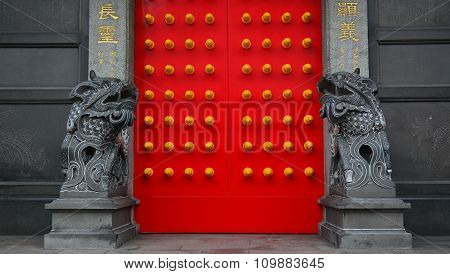 Chinese Stone Lion In The Temple With Red Door