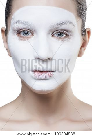 young pretty woman with facial white mask isolated close up