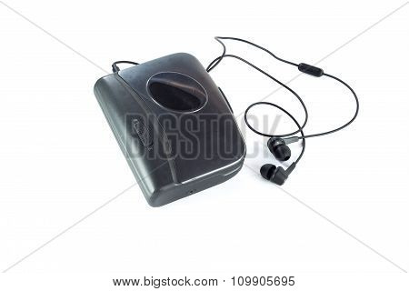 Cassette Player And Black Earphones Isolated