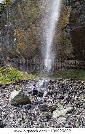 Swiss Alps Waterfall Near Oeschinensee Lake In Bernese Oberland, Switzerland
