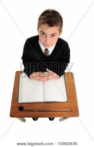 School Boy Sitting At School Desk