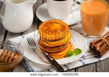 Pumpkin pancakes with honey