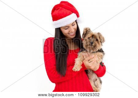 Woman wearing sant hat holding a dog