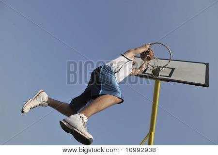 basketball player practicing and posing for basketball and sports athlete concept poster