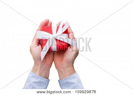 Man holding a red gift box with white ribbon