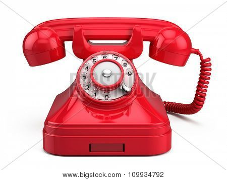 Old retro red phone isolated on white