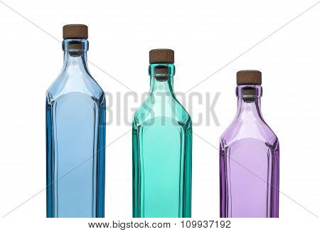 Empty blue aqua and purple glass bottle